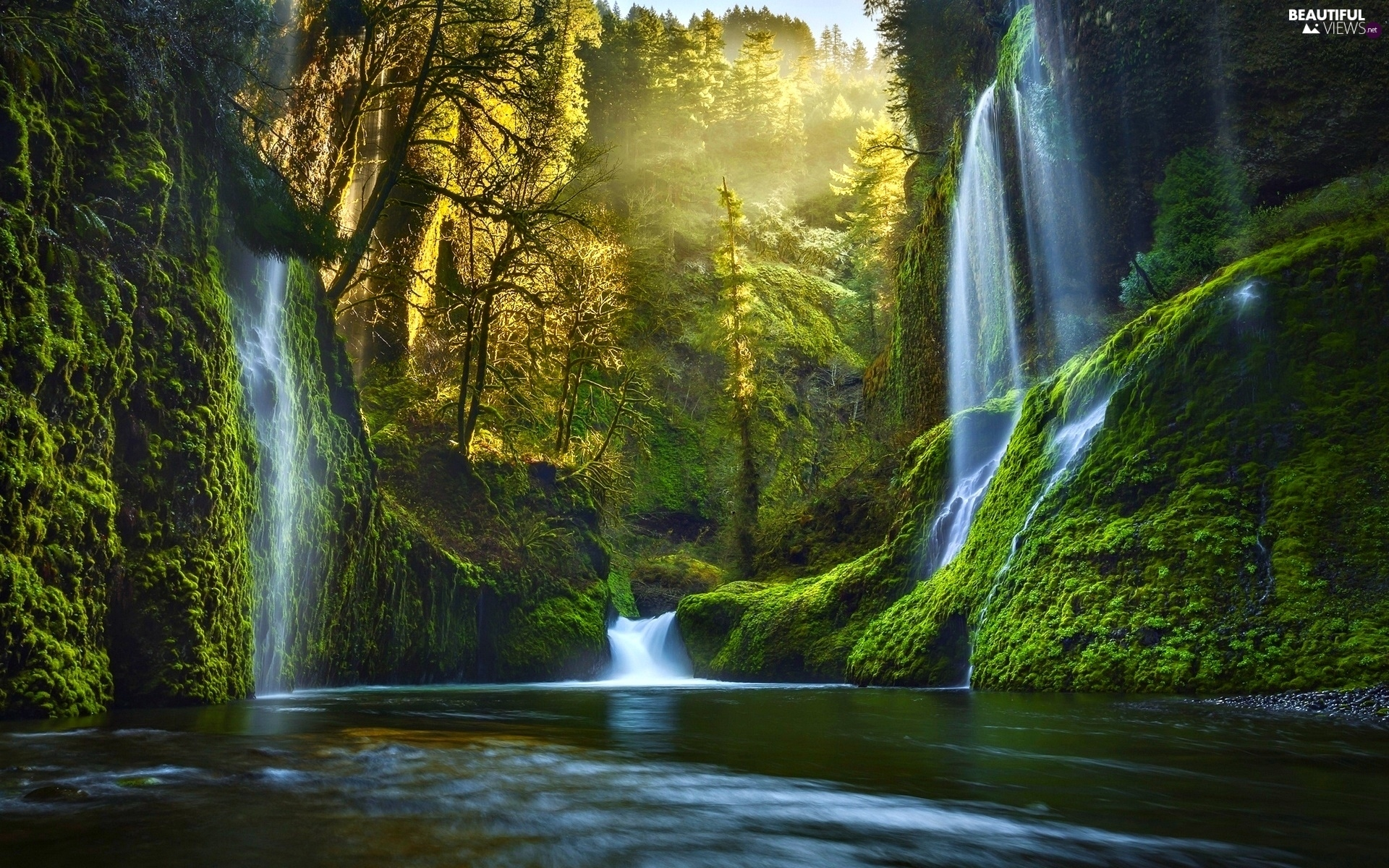 http://www.beautiful-views.net/views/breaking-light-waterfall-river-sky-through.jpg