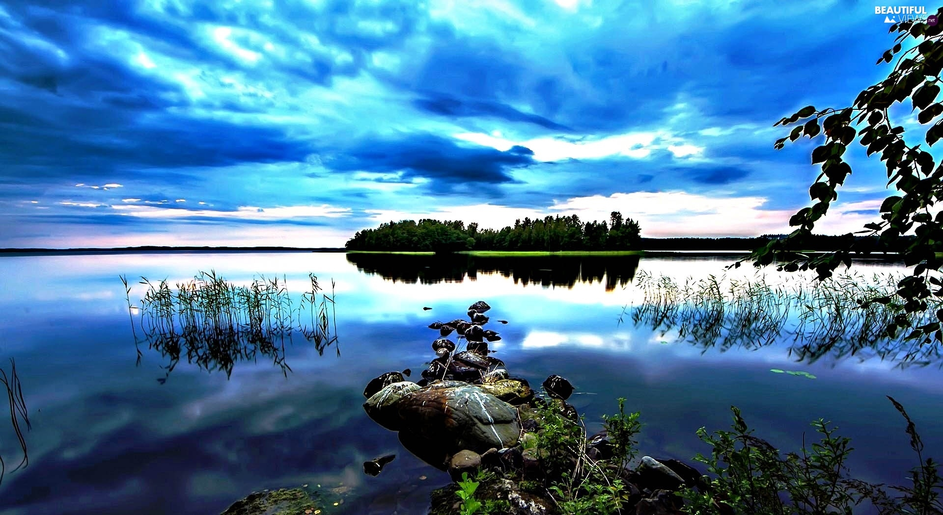 Stones, lake, clouds